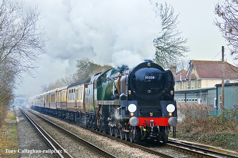 """18th Feb 11:  On a misty and murky day 35028 """"Clan Line"""" accelerates away from Chertsey with the day's running of the VSOE  'Surrey Hills Luncheon Special'"""