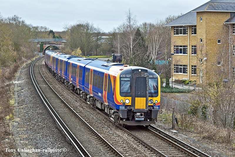 6th Feb 11:  the 10.42 from Haslemere to Waterloo at Peasmarsh.  450127 & 120 are working 2P32