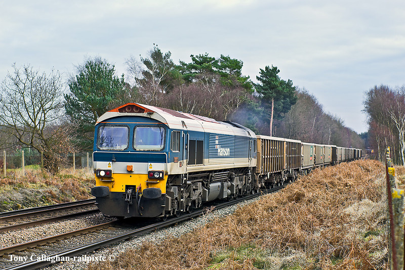24th Jan 11:  Passing between Wentworth Golf Course and Chobham Common is 59101 hauling 7V67 empty MRL boxes from Sevington to Whatley
