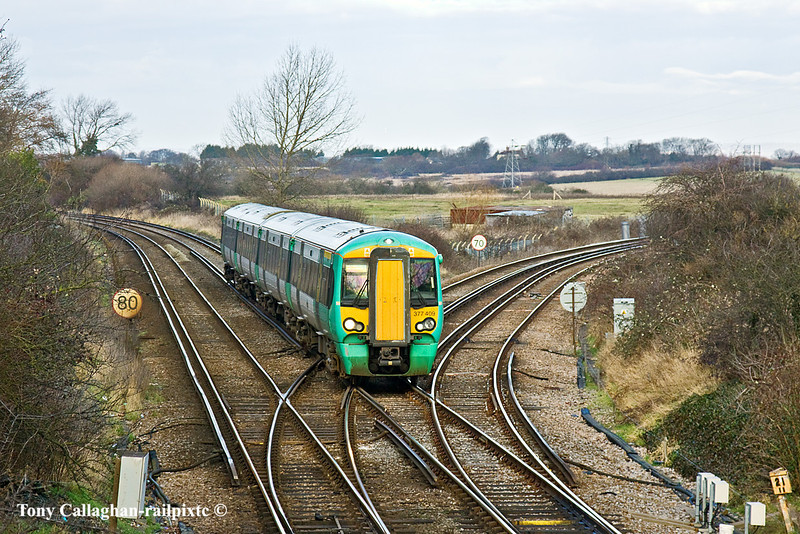 16th Jan 11:  Crossing Willingdon Juncton is 1F14 from Haywards Heath to Eastbourne. When combined with the Littlehampton train it had started from Victoria at 10.17