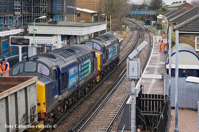 12th Jan 11:  Running through South Acton are 37510 & 37688 taking empty scrap boxes from Sheerness to Stockton