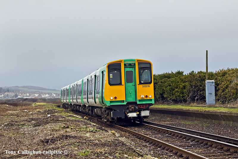 17th Jan 11:  Starting the climb up to Bishopstone Station  is 313215 on the 12.10 from Brighton to Seaford.  The abandonned station is Bishopstone Beach Halt closed on 1st January 1942