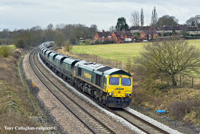 25th Jan 11:  Rounding the curve through Woolhampton is 66597 and 6A21 from Pengam to Theale