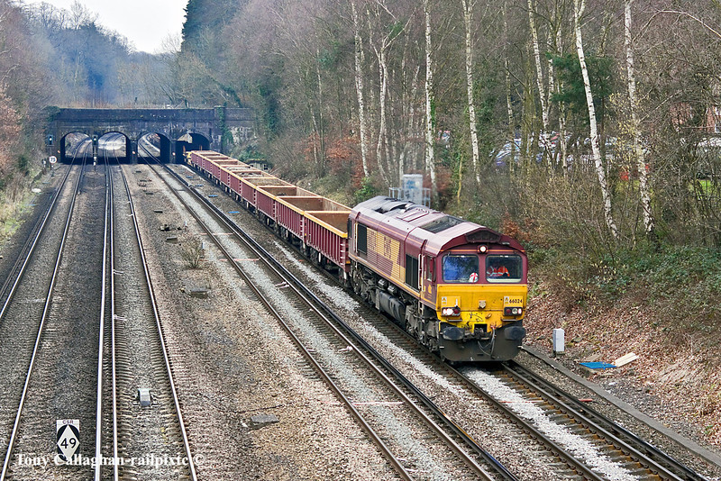 29th Jan 11:  The Millbrooke to Eastleigh, via Romsey, Andover and with reversal at Woking, departmental (6N03) is passing under the Basingstoke canal in Frimley Green with 66024 doing the honours. The varied waggon  load included MLA, OCA, OBA,  KWA  and sundry odds and sods.