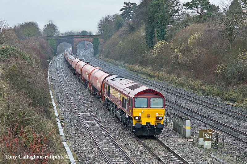 25th Jan 11:  In steady rain 59205 heads east passed Westbury Lane in Purley on Thames with the empty Murco oil tanks from Theale to Robeston