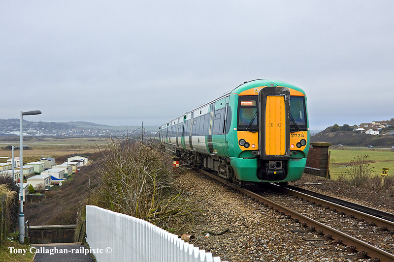 17th Jan 11:  377314 runs downhill away from Bishopstone with the 11.25 from Seaford back to Brighton