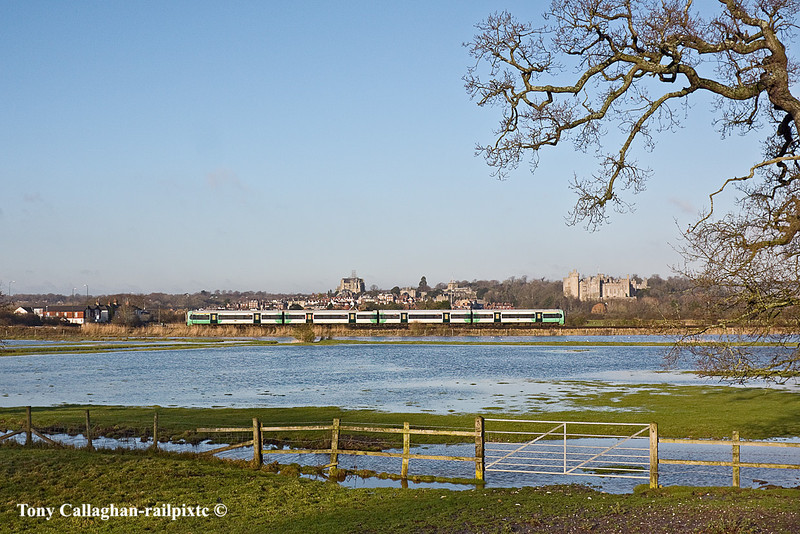 18th Jan 11:  Passing through Arundel and the flooded Arun Valley is the 09.10 from Southhampton to Horsham.  Here 1C29 will combine with 1C27 from Bognor and continue to Victoria