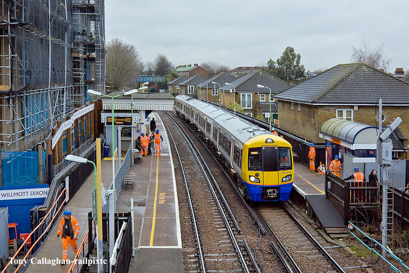 12th Jan 11:   With new lighting being installed South Acton Station is swarming with High Viz as 378220 makes it's stop.  2N37 is the 10.06 from Stratford to Richmond