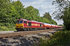 14th Jul 11:  Pictured in the cutting west of Pangbourne is 60049 woking 6B33 Murco empties back to Robeston from Theale