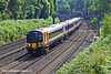 5th Jul 11:  444013 rounding the curve at Pirbright with a service to Weymouth from Waterloo