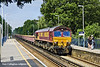 3rd Jul 11:  Rattling through Sunningdale is 66092 and 6N03 carrying spent ballast in MLAs, from track replacement near Camberley, back to Hoo Junction