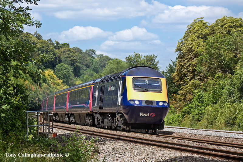 14th Jul 11:   The leading power car on the 11.48 Paddington to Cheltenham is 43148. Pictured here racing through the cutting towards Pangbourne