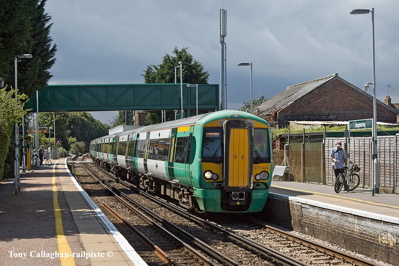 19th Jul 11:  Starting from Littlehampton 1H37 is making for Haywards Heath where 377444+413 will combine with  a service from Eastbourne and continue to Victoria at 1F37.  Seen here calling at Angmerang under a very threatening sky.