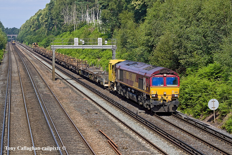 5th Jul 11:  The  Eastleigh to Hoo Junction Departmental service has 61612 on the point.   6Y41is captured as it runs though the deep cutting at Pirbright