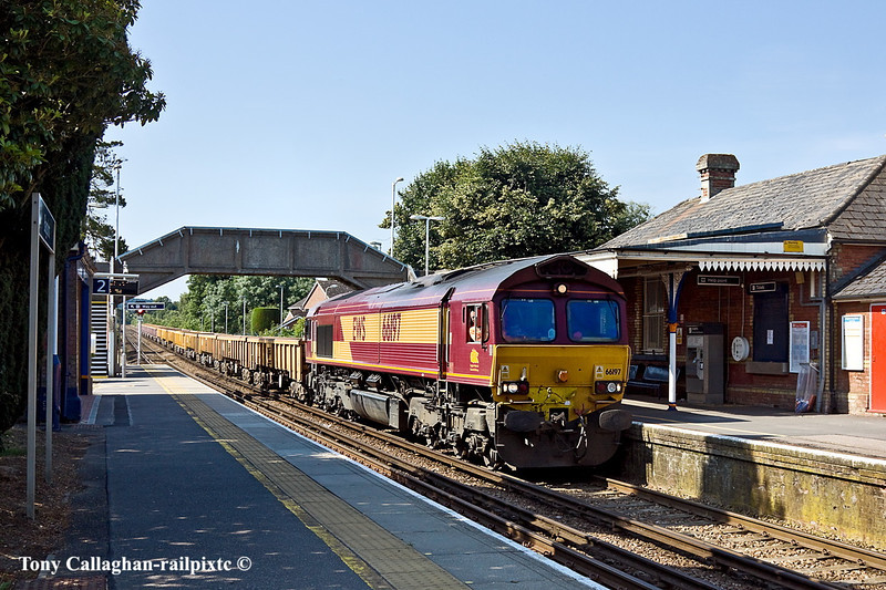 3rd Jul 11:  With JNA & MLAs filled with spent ballast fron track relaying towards Camberley 66197 works 6N02 through Bagshot and away to Hoo Junction