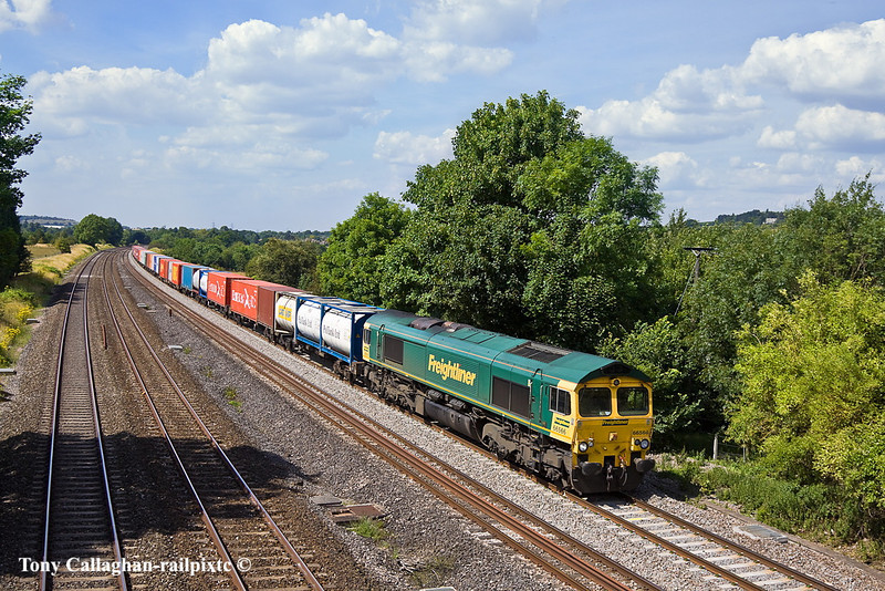 14th Jul 11:  At Lower Basildon 66566 hurries south with 4O27 from Garston