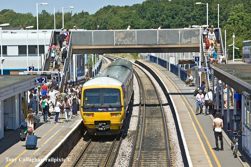 26th Jun 11:  The 11.08 from Gatwick is composed of a 2 car FGW Turbo 165127.  Terminating at Wokingham due to engineering work towards Reading the very considderable number of passengers must continue to Reading on a very hot bus.