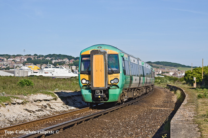 3rd Jun 11:  Running through the long closed Halt at Tide Mills is 377448 with the 07.40 from Brighton.  This set will next work the 08.21 Seaford to Victoria.