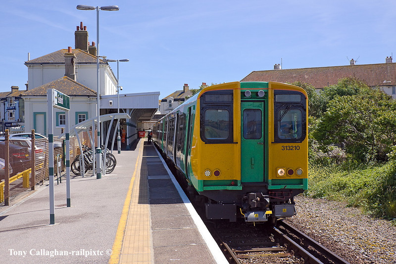 3rd Jun 11:  Sitting in Seaford's only platform, Number 2 !!  is 313120 waiting to form 2F66 the 13.58 tp Brighton