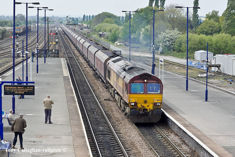 5th May 11:  66176 powers 4R15 empty hoppers frpm Drax Power Station to Immingham through Barnetby