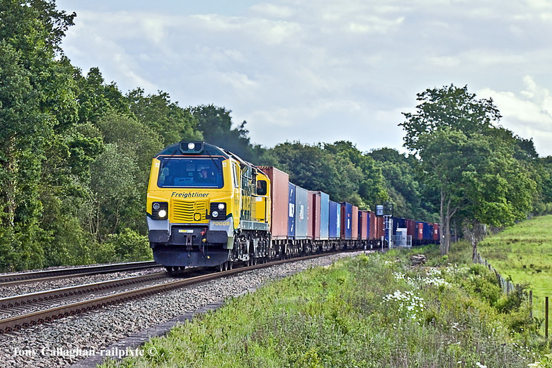 20th May 11:  Approaching Danes Crossing near Grazely is 70008 working to Trafford Park from Southampton wiith 4M99