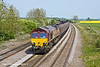 5th May 11:  Running towards the level crossing at New Barnetby is 66067 hauling 6C77 from Immingham to Scunthorpe