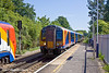 25th May 11:  458017 and the 09.42 Reading to Waterloo  is ready to  depart from Egham as 450567 runs though on an empty stock move