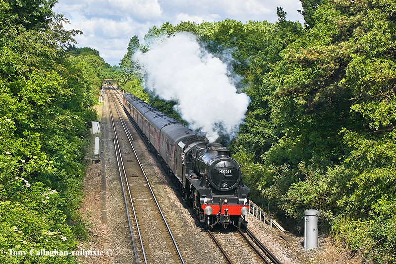 "14th May 11:  Powering the ""Swanage Belle"" over the M3 and through Lyne is LMS Balck 5  45305.  70013 'Oliver Cromwell' would work the return journey"