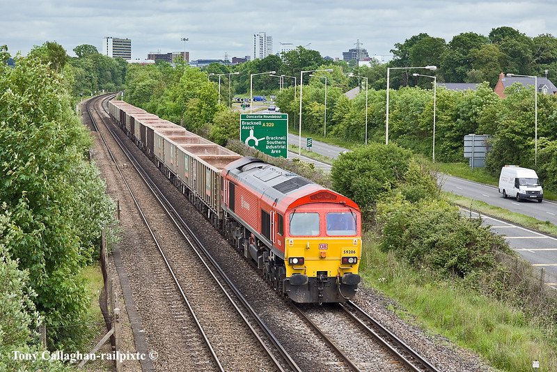 18th May 11:  Pictured at Amen Corner in Bracknell is 59206 with the empty MRL boxes from Sevington to Merehead