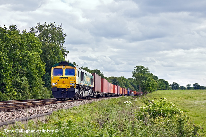 20th May 11:  Normally now a Class 70 turn 66567 works 4M68 from Southampton to Birch Coppice.  Seen here nearing Danes Crossing in Grazely