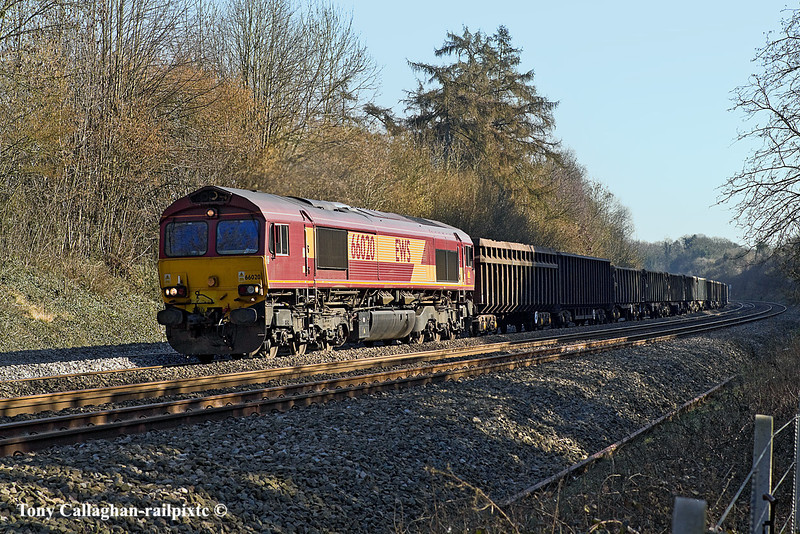 7th Mar 11:  Charging through the cutting to the west of Pangbourne is 66020 with loaded spoil from Bow Olympic to Appleford