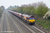 31st Mar 11:  Coal hoppers on the GWML east of Reading are unheard of.  66095 trundles past at Shottesbrooke.  4V36  is taking empties back to Tilbury where they are loaded with redundant coal and transprted to be transported back to Didcot