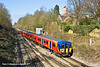 19th Mar 11:  The 13.22 from Waterloo to Weybridge is in the hands of 455713. Seen here taking the Weybridge line ar Virginia Water