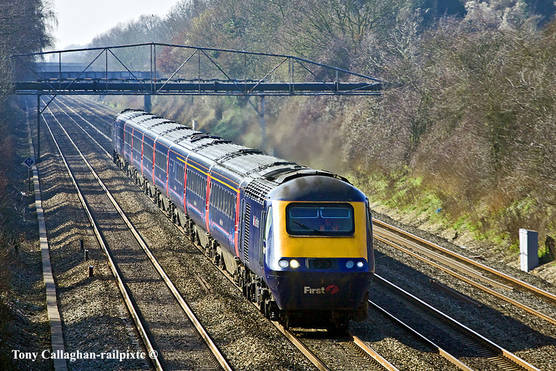 4th Mar 11:  The 11.30 from Bristol Temple Meads with 43104 on the point passes under the pipe bridge at Shottesbrooke