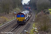 21st Mar 11:  6V38 is the MoD service from Marchwood to Didcot today headed by 66138 rushing through Silchester