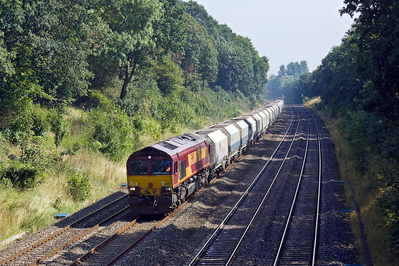 2nd Sep 11:  On a slightly hazy morning 66102 plods through the Sonning Cutting with 6B35 hayes to Moreton on Lugg empty hoppers