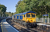 28th Sep 11:  66730 crawls round the sharp corner onto the Chertsey line at Virginia Water with the Empty Gypsun containers from Mountfield to Southampton Western Docks
