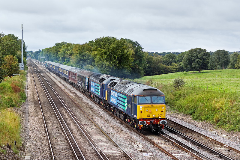 18th Sep 11:   Roaring up the grade between Hook and Winchfield are 47802 & 47841 heading the Cruise Saver Express.  1Z60 runs from Southampton to Glasgow