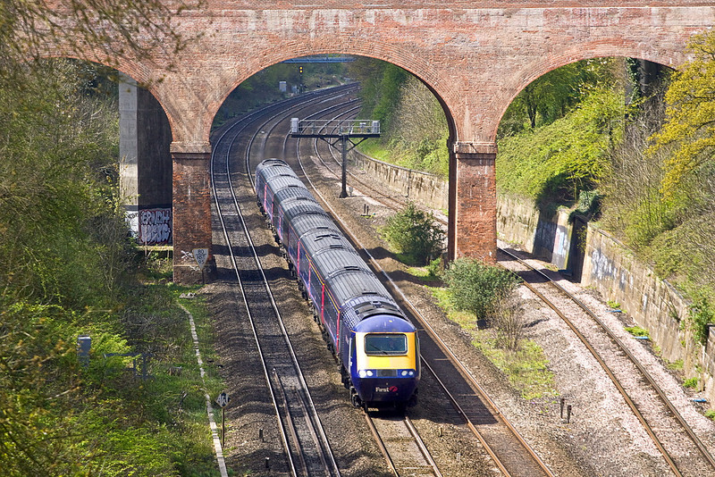 16th Apr 12:  Passing under the A4 road bridge at the start of the Sonning Cutting is the 11.30 from Bristol Temple Meads to Paddington