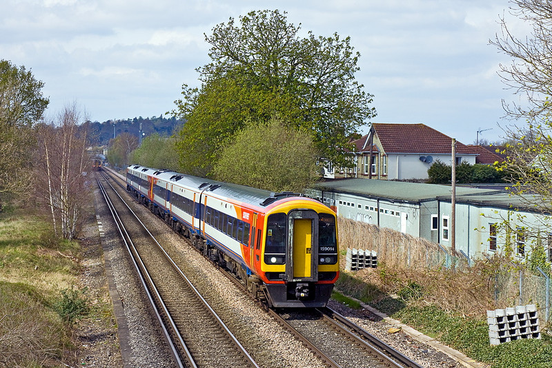 6th Apr 12:  The prommised cloud is now forming as 159014 & 012 cross Addlestone Moor in Chertsey working 1L37 the 12.50 from Waterloo to Exeter St Davids