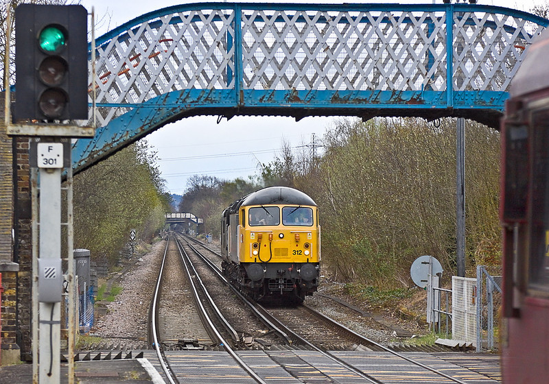 3rd Apr 12:  As there was not much chance of sun I chose Chertsey to get a picture of 56312 taking 37905 from Alton to Burton.  The afternoon departmental from Hoo Junction to Eastleigh powered by 66194 chose exactly the wrong moment to  get in on the act.