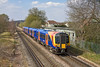 2nd Apr 12:  The 13.22 from Waterloo to Weybridge  formed of 150558  pulls away from Chertsey