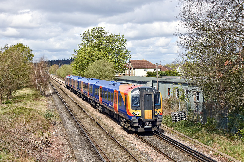 10th Apr 12:  Running 17 minutes late  the 10.22 from Waterloo to Weybridge (2S25) formed of 450552 runs away from Chertsey