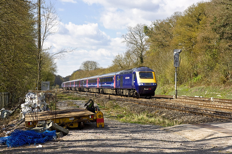 16th Apr 12:  43037 races out from the Sonning Cutting and past the usual Network Rail detrius  while working the 10.30 from Bristol Temple Meads to Paddington.
