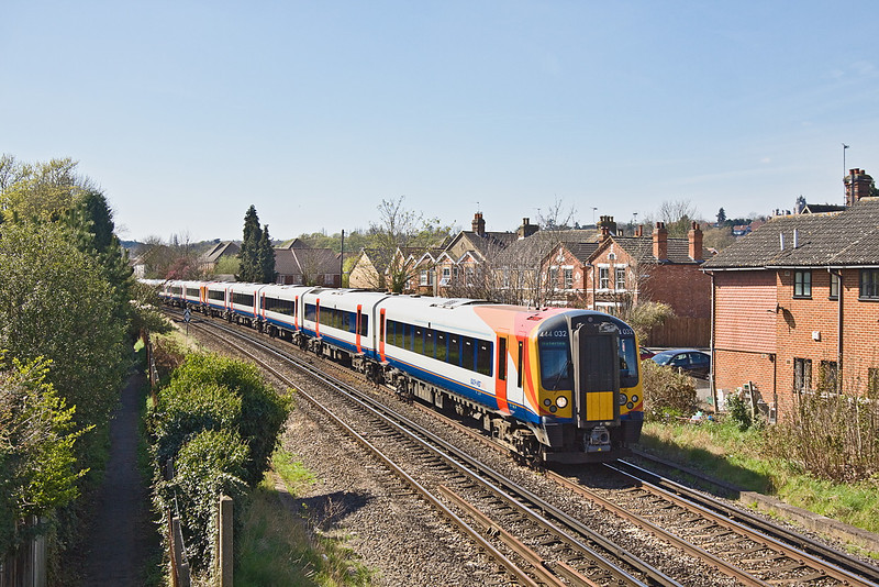 6th Apr 12:  The diverted 09.19 from Weymouth to Waterloo approaches Egam formed of 444032 and 444005