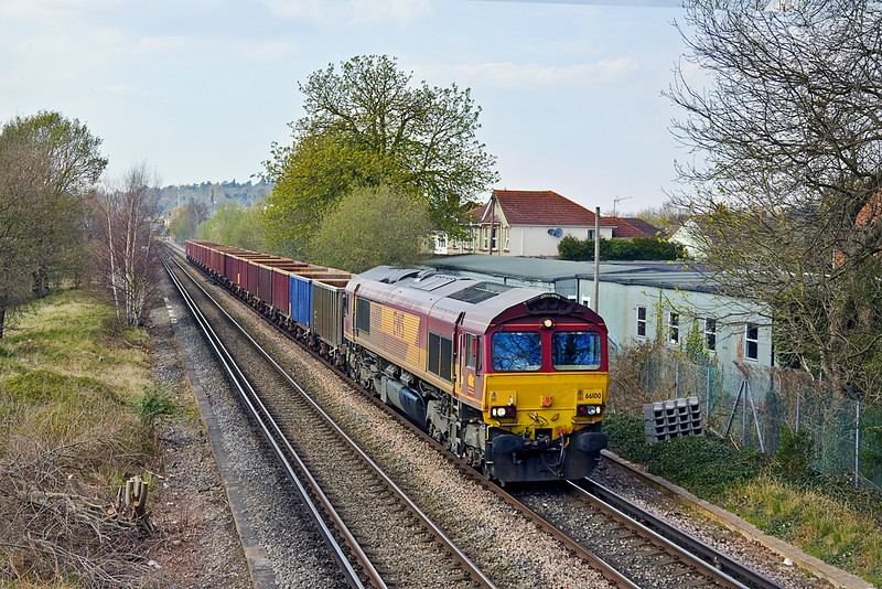 2nd Apr 12:  66100 plods across Addlestone Moor with a rake of four wheel boxes.  6Z67 is from Wembley to Eastleigh