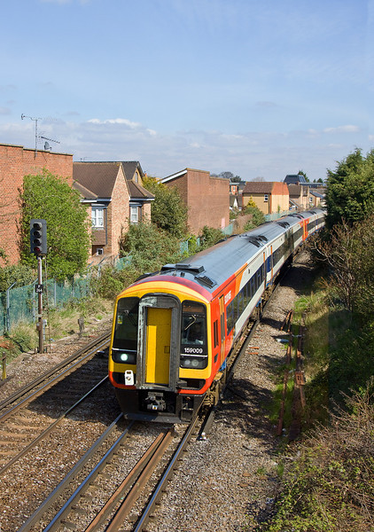 6th Apr 12:  159009 hurries away from Egham with a diverted 1L33 the 11.49 Waterloo to Exeter.  Line closure at Weybridge, Hersham and Surbiton being the reason for the diversions