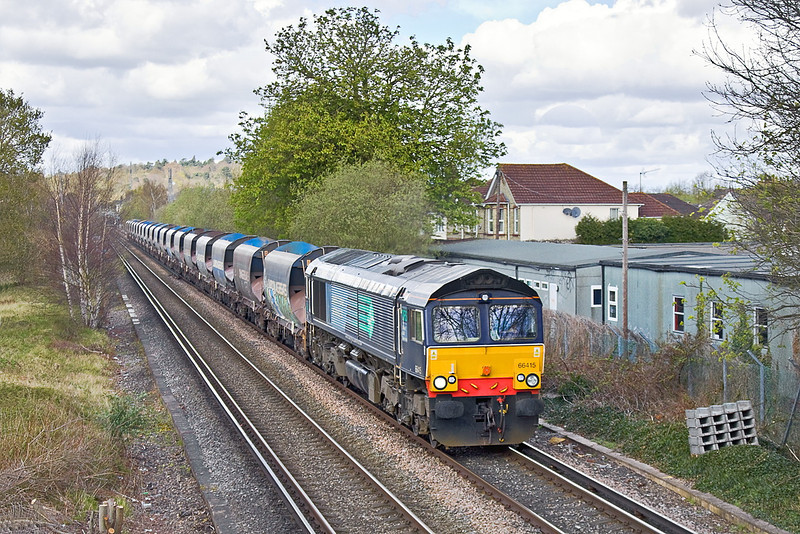 10th Apr 12:  Just missing the sun is Ex DRS 66415 now with Freightliner working 6O49 sand empties from Neasden to Wool across Addlestone Moor in Chertsey