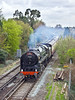 12th Apr 12:  70000 has just shut off as it rounds the curve past Coxes Lock in Addlestone  witrh the day's Cathex to Bristol from Victoria