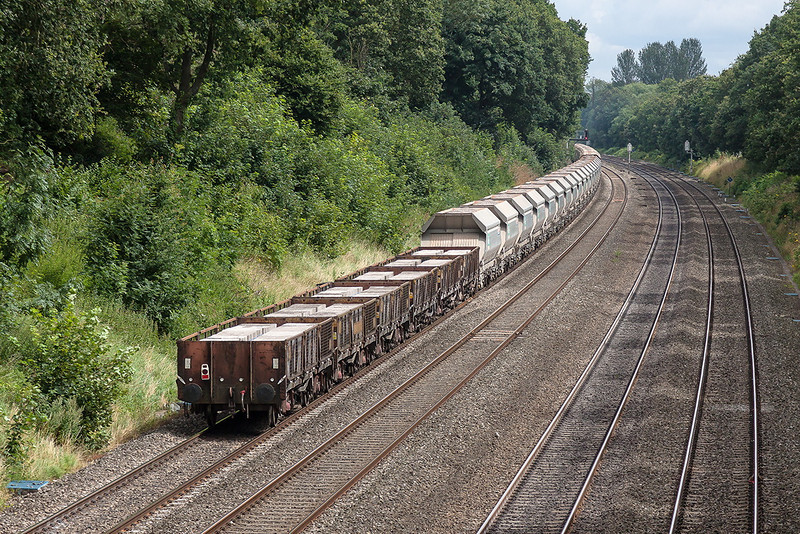 6th Aug 12:  With 38  100 Tonners and 6 OAAs on the hook 7A09 from Merehead to Acton pwered through the Sonning Cutting by 59102  makes an impreive sight